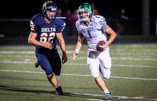 New Castle's William Grieser avoids a Delta player during the Trojans' game against the Eagles at Delta High School on Sept. 27, 2019.