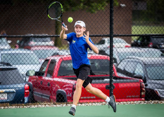 FILE -- Burris freshman Charlie Behrman hits a ball during the Delta Tennis Invitational at Delta High School Saturday, Sept. 28, 2019. Behrman beat Delta's Tanner Southerland in the sectional championship and earned a spot in the IHSAA individual state tournament.