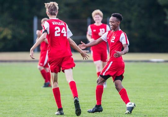 Wapahani's Jackson and Sofani Buck celebrate a goal against  Blackford's during their game at Wapahani High School.