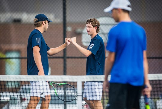 FILE -- Delta's Jaigen Glaze and Walker Boyle face off against Burris during the Delta Tennis Invitational at Delta High School Saturday, Sept. 28, 2019. The two were one of four positions to win as Delta won its 27th-straight championship over Burris.