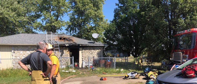 Firefighters from three local volunteer departments battled a house fire in the 5700 block of North Ind. 67 on Saturday afternoon