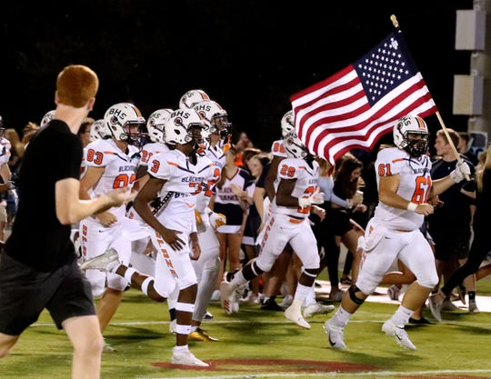 Blackman players run onto the field prior to Friday's contest at Riverdale. The Blaze play host to Oakland Friday.