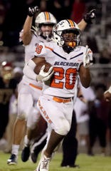 Blackman's Jaden Layne (20) celebrates an interception that he returned inside the 10 and led to a Blaze touchdown during a 23-22 win over Riverdale Friday.