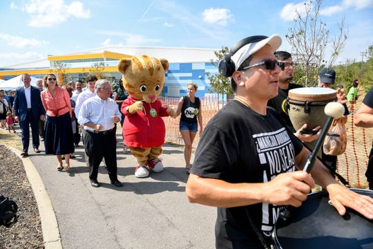 Nashville Mayor John Cooper walks with supporters in a parade during the Good Neighbor Day Festival after his inauguration at the Southeast Community Center Saturday, Sept. 28, 2019, in Antioch, Tenn.