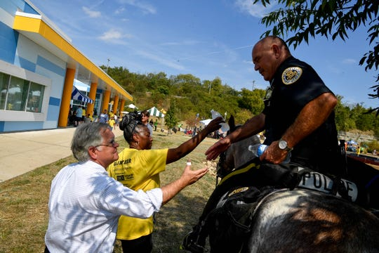 Nashville Mayor John Cooper shakes hands with a Metropolitan Nashville Police officer after his inauguration at the Southeast Community Center Saturday, Sept. 28, 2019, in Antioch, Tenn.