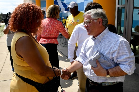 Nashville Mayor John Cooper shakes hands during the Good Neighbor Day Festival after his inauguration at the Southeast Community Center Saturday, Sept. 28, 2019, in Antioch, Tenn.