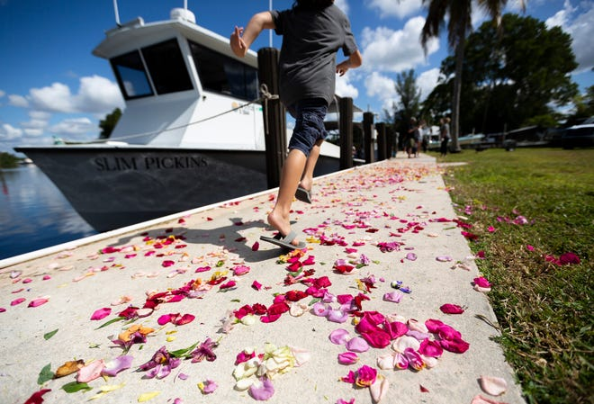 Turner Shealy, 7, runs past the Slim Pickins during the Blessing of the Stone Crab Fleet event at the Rod & Gun Club on Saturday, Sept. 28, 2019 in Everglades City. The Blessing of the Stone Crab Fleet is a tradition that began centuries ago in Mediterranean fishing communities and is meant to ensure a safe and bountiful season.