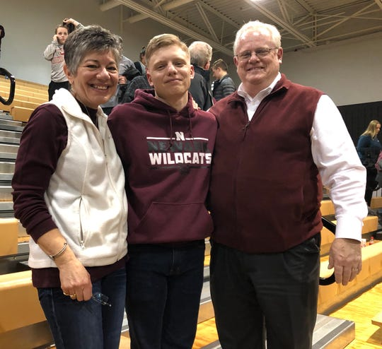 Mayor Jeff Hall, right, with wife, Helen, and son, Philip, at a Newark basketball game in March 2019.
