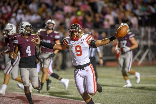 Bergen Catholic at Don Bosco football on Friday, September 27, 2019. BC #9 Ryan Butler celebrates after scoring a touchdown in the first quarter.
