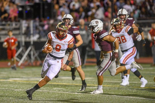 Bergen Catholic at Don Bosco football on Friday, September 27, 2019. BC #9 Ryan Butler on his way to scoring a touchdown in the first quarter.