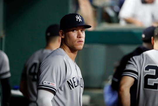 New York Yankees' Aaron Judge stands in the dugout in the seventh inning of a baseball game against the Texas Rangers in Arlington, Texas, Friday, Sept. 27, 2019. (AP Photo/Tony Gutierrez)