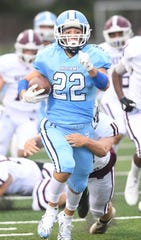 Wayne Valley's John Testa runs for a first down a week ago against Wayne Hills. Against Passaic Valley on Saturday, Testa was the leading rusher for the Indians with 80 yards on 13 carries.