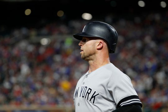 New York Yankees' Brett Gardner walks to the dugout after hitting a solo home run in the fourth inning of a baseball game against he Texas Rangers in Arlington, Texas, Friday, Sept. 27, 2019. (AP Photo/Tony Gutierrez)
