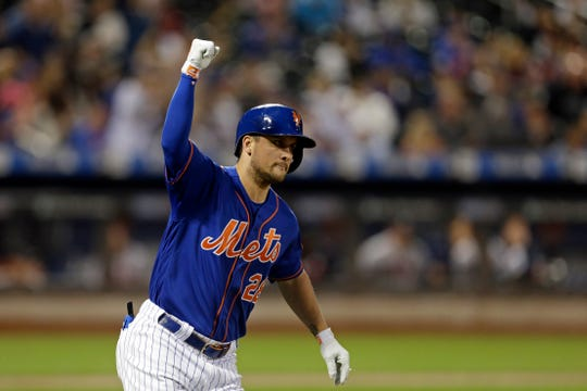 New York Mets' J.D. Davis celebrates after hitting a two-run home run during the fourth inning of a baseball game against the Atlanta Braves on Friday, Sept. 27, 2019, in New York. (AP Photo/Adam Hunger)