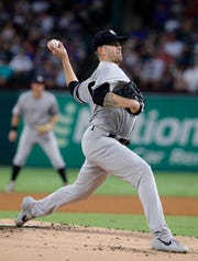 New York Yankees starting pitcher James Paxton throws to the Texas Rangers in the first inning of a baseball game in Arlington, Texas, Friday, Sept. 27, 2019. Paxton did not return to throw in the second inning. (AP Photo/Tony Gutierrez)