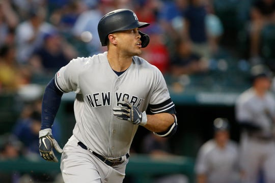 Sep 27, 2019; Arlington, TX, USA; New York Yankees left fielder Giancarlo Stanton (27) watches his home run in the first inning against the Texas Rangers  at Globe Life Park in Arlington. Mandatory Credit: Tim Heitman-USA TODAY Sports