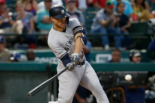 Sep 27, 2019; Arlington, TX, USA; New York Yankees left fielder Giancarlo Stanton (27) hits a home run in the first inning against the Texas Rangers  at Globe Life Park in Arlington. Mandatory Credit: Tim Heitman-USA TODAY Sports