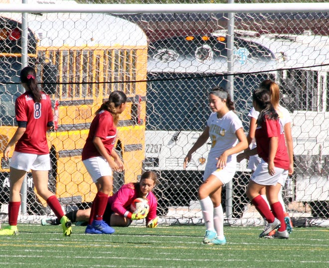 Junior Lady 'Cats goal keeper Palmira Valentine (with ball) was kept busy in the net on Saturday. Valentine turned away 11 of 21 shots.