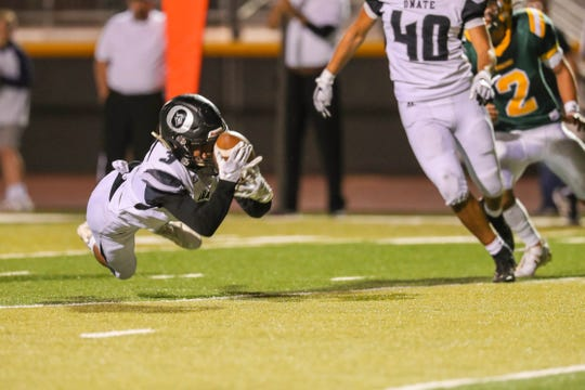 Junior cornerback Diego Quinonez (3) intercepts a pass as the Mayfield Trojans face off against the Oñate Knights at the Field of Dreams in Las Cruces on Friday, Sept. 27, 2019.
