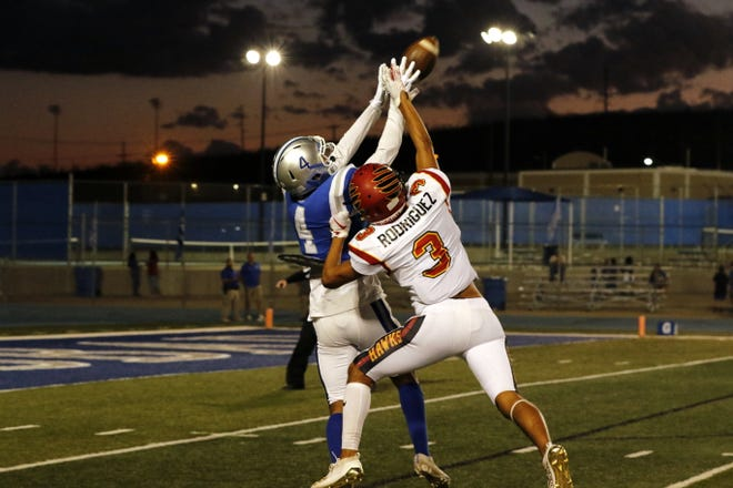 Carlsbad's Jonathan Galindo (4) intercepts a pass from Centennial's Aidan Trujillo denying Darren Rodriguez (3) a catch in the first quarter of Week 6's game on Sept. 27, 2019. Carlsbad will once again host Centennial during the shortened season in 2021.