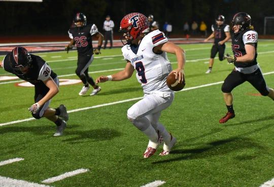 Livonia Franklin quarterback Jacob Kelbert gets the Patriots near the Churchill endzone with this scramble.