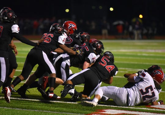 The Livonia Churchill Chargers snow under a Franklin Patriot running back.