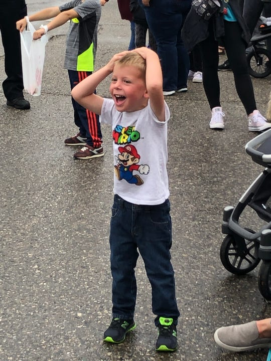 Tanner Hollandsworth, 3, of South Lyon, is enthusiastic about the Pumpkinfest Parade, Sept. 28, 2019.