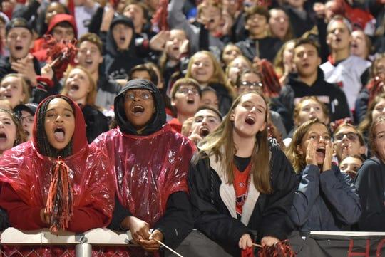 Livonia Churchill fans serenade their team with praise during their Sept. 27 home game.
