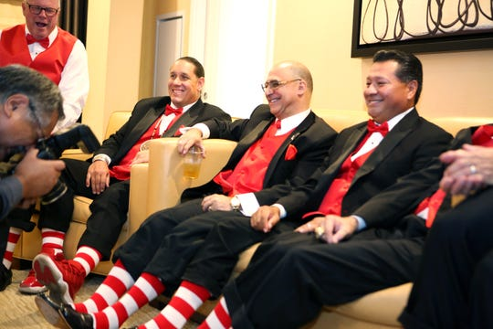 Ronald McDonald House award honorees Dan Horn, left, Jeff Grubbe, Patrick Evans, Ernesto Rosales smile as a photographer takes a photograph of their socks prior to the gala at Agua Caliente Resort Casino Spa in Rancho Mirage, Calif., on Friday, September 27, 2019.