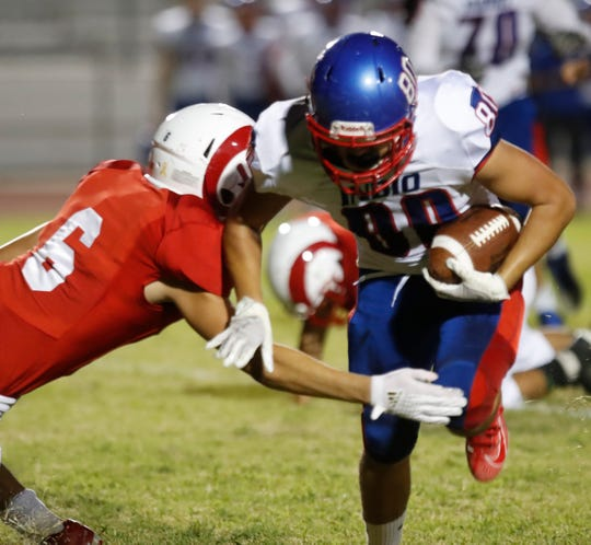 Adrian Velasquez of indio High School runs for yardage during his team's game against Desert Mirage High School in Thermal on September 27, 2019.