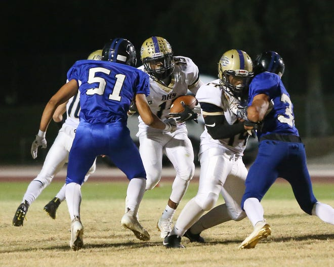 Desert Hot Springs running back Darian Johnson runs up the middle against Cathedral City in high school football Sept. 27, 2019.