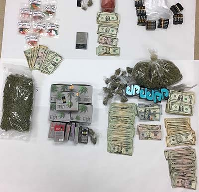 The Coachella Valley Violent Crime Gang Task Force found marijuana, heroin, cash and three dogs at the suspected drug house, according to the sheriff's department.