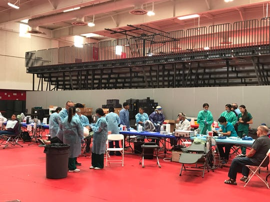 Volunteer dentists provided free dental care to clinic visitors on Saturday at Desert Mirage High School.