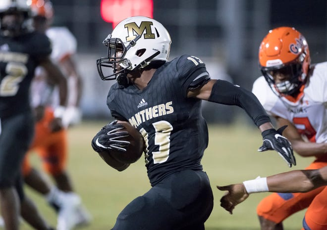 Kam Hall (13) carries the ball during the Escambia vs Milton football game at Milton High School on Friday, September 27, 2019.