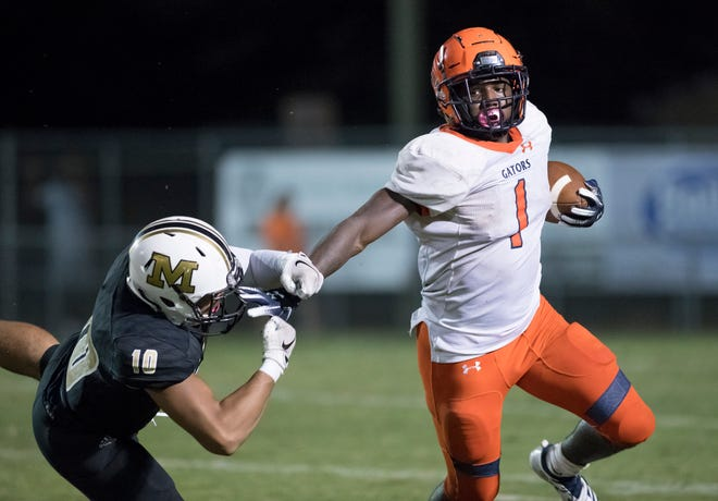 Frank Peasant (1) gets past DC Barbour (10) for a first down during the Escambia vs Milton football game at Milton High School on Friday, September 27, 2019.