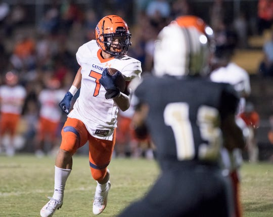 Jojo Blackmon (7) looks for a hole during the Escambia vs Milton football game at Milton High School on Friday, September 27, 2019.