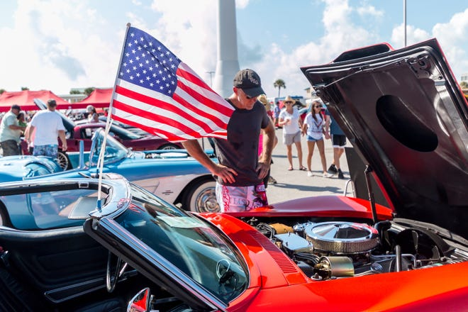 People check out the corvettes on display in the Casino Beach parking lot during a past Vettes at the Beach. This year's event takes place on Saturday.