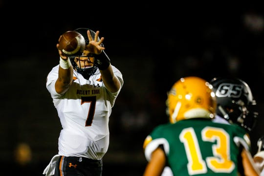 Desert Edge quarterback Adryan Lara catches a snap during the first half of a game against Peoria on Sept. 27.