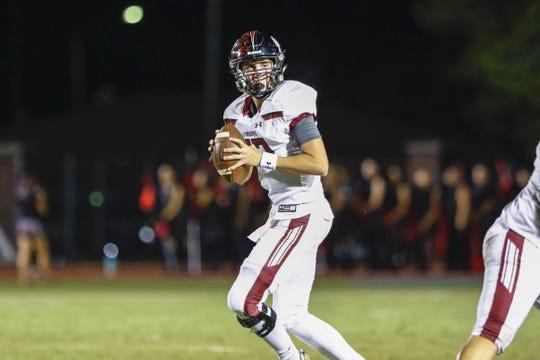 Desert Ridge Quarterback Austin Kolb drops back to pass against Chandler High School on Sep. 27, 2019 in Chandler, Ariz.