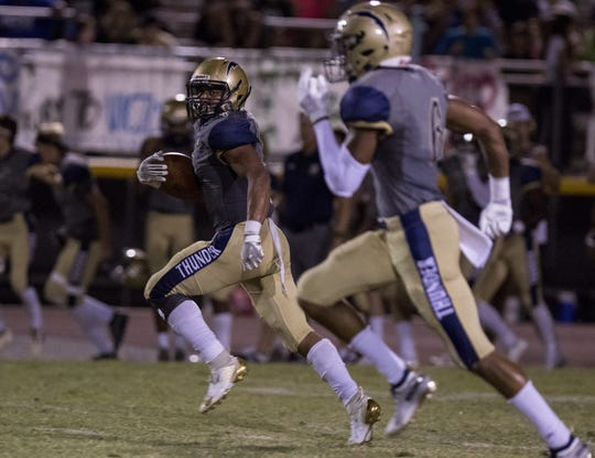 Desert Vista's Tyson Grubbs (7) finds running room for a touchdown against Highland's defense during the second half of their game in Phoenix, Friday, Sept. 27, 2019.