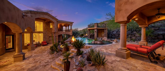 A nighttime view of the $2.7 million Peoria mansion with resort-style backyard for sale.