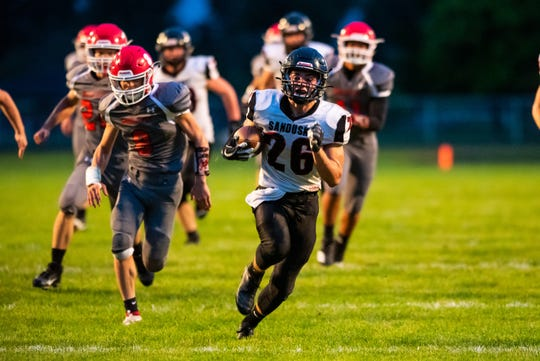 Sandusky running back Delorrin Wedge (26) runs with the football during the second quarter of their game against Marlette Friday, Sept. 27, 2019, at Marlette High School. Wedge's run gave Sandusky their third touchdown of the game.