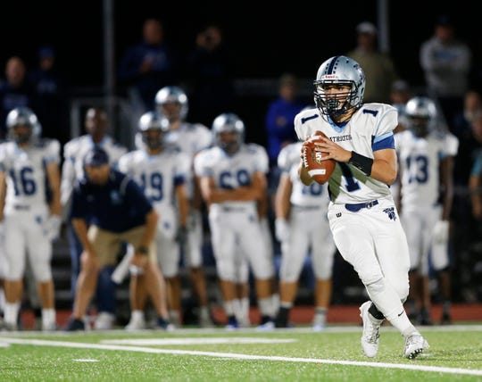 John Jay quarterback Danny Beal drops back to throw during a Sept. 27 game against Roy C. Ketcham.