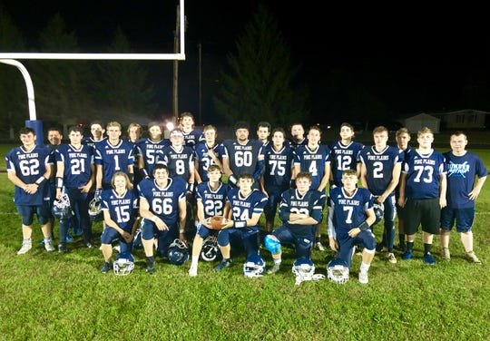 The Pine Plains/Rhinebeck football team poses on its home field after beating Spackenkill on Friday.
