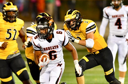 Northeastern junior running back Manny Capo was, center, was held to 81 rushing yards and a touchdown in the loss at Red Lion.
