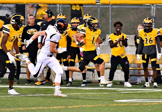 Red Lion junior wide receiver Randy Fizer, right, runs away from a Northeastern defender on his way to a touchdown. Fizer had three touchdowns and 211 receiving yards in the game.