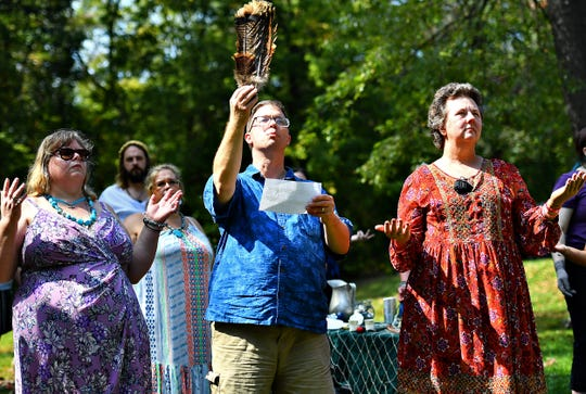 A harvest ritual is performed as the main ritual of the day, to honor both the harvest time of year and to cultivate community, during the 8th annual Pagan Pride Festival at Samuel S. Lewis State Park in Lower Windsor Township, Saturday, Sept. 28, 2019. Dawn J. Sagert photo