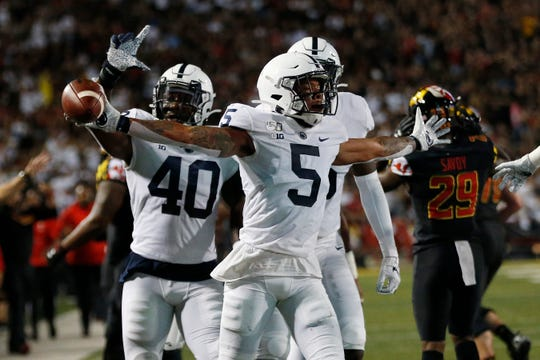 Sep 27, 2019; College Park, MD, USA; Penn State Nittany Lions cornerback Tariq Castro-Fields (5) celebrates after intercepting a pass against the Maryland Terrapins in the first quarter at Capital One Field at Maryland Stadium. Mandatory Credit: Geoff Burke-USA TODAY Sports