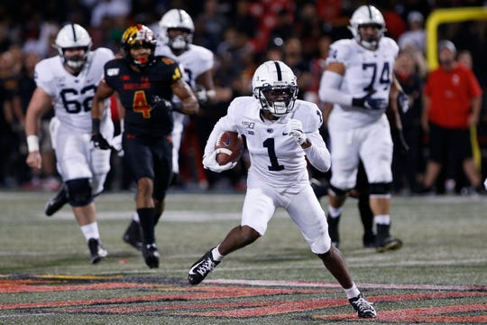 Sep 27, 2019; College Park, MD, USA; Penn State Nittany Lions wide receiver KJ Hamler (1) runs with the ball en route to a touchdown against the Maryland Terrapins in the first quarter at Capital One Field at Maryland Stadium. Mandatory Credit: Geoff Burke-USA TODAY Sports