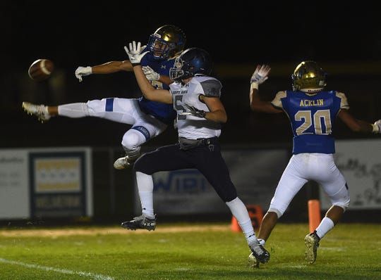 Reed's Jared Cabales (13) breaks up a pass intended for  Damonte Ranch's Ian Williams in Sparks on Sept. 27, 2019.